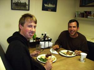 Two guys eating at table