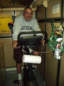 Scott Sperber riodes the exercise bike.