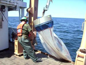 Scott Sperber revoers the bongo net aboard ship.