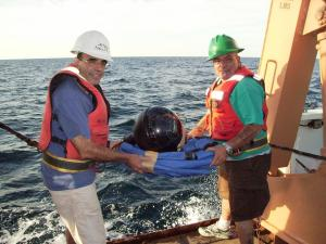 Scott and Jerry hold decorated buoy