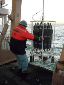 Crewman brings aboard a CTD sampler