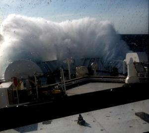 huge wave hits ship's bow