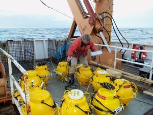 WOman checks pop-ups opn deck of ship