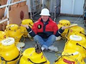 Todd Wilson sitting amongst pop-up buoys