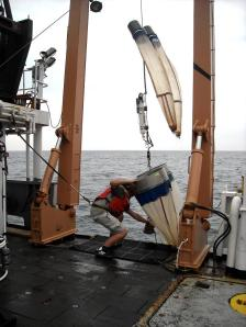 bono net being retrived aboard ship