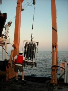Water sampler retrirved at sunset through the A-frame on the Delaware II.