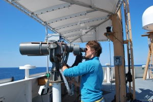 Using big eyes to watch for whales and dolphins on a marine mammal survey on the Henry B Bigelow