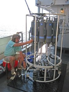 Mary Scranton collects water samples from rosette water sampler.