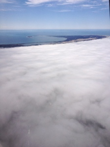 A fog blanket  May 1 over Cape Cod and nearby waters, taken from the NEFSC;'s aerial survey airplane, a NOAA Twin Otter.  Credit: Christin Khan, NEFSC.NOAA