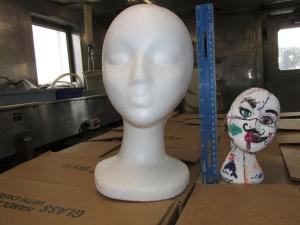 two manikin heads, one compressed by ocean water pressure