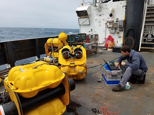 Deep ocean sound recorders on the deck of a research dhip