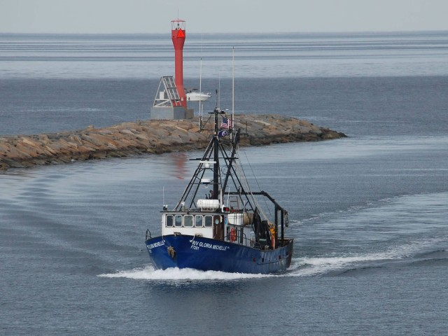 Small research trawler entering harbor